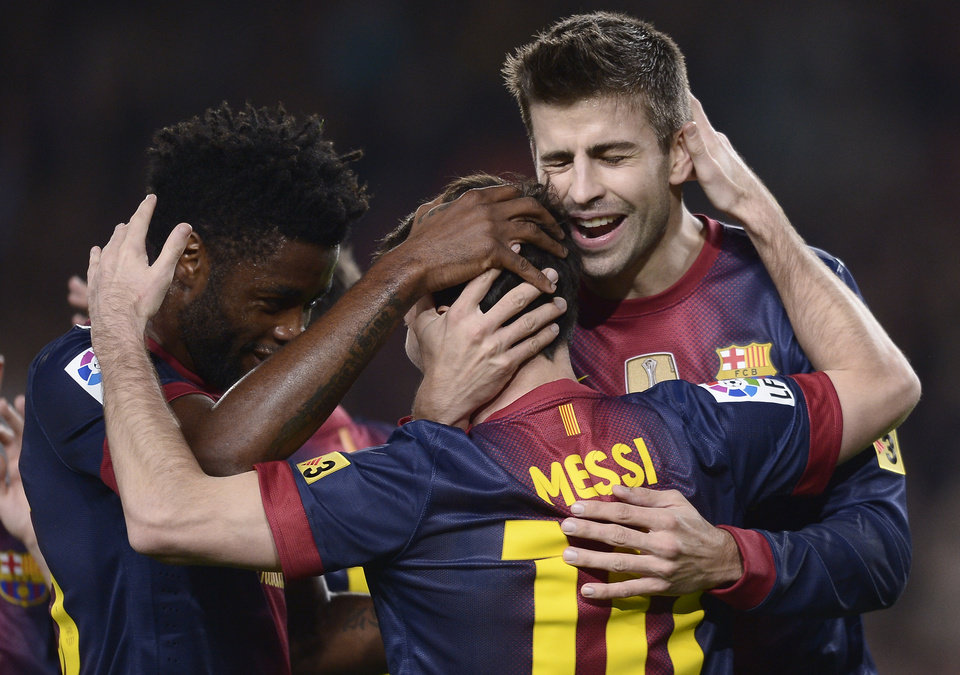 Photo -   FC Barcelona's Lionel Messi, from Argentina, center, reacts after scoring against Zaragoza with teammates Alex Song, left, and Gerard Pique during a Spanish La Liga soccer match a at the Camp Nou stadium in Barcelona, Spain, Saturday, Nov. 17, 2012. (AP Photo/Manu Fernandez)