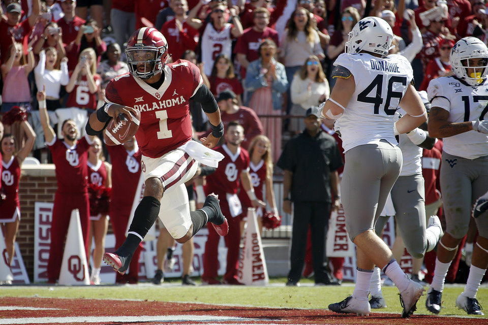 Photo - Oklahoma's Jalen Hurts (1) scores a touchdown during a college football game between the University of Oklahoma Sooners (OU) and the West Virginia Mountaineers at Gaylord Family-Oklahoma Memorial Stadium in Norman, Okla, Saturday, Oct. 19, 2019. [Bryan Terry/The Oklahoman]