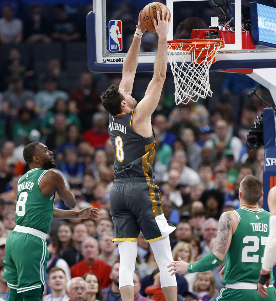 Photo - Oklahoma City's Danilo Gallinari (8) dunks the ball between Boston's Kemba Walker (8), left, and Daniel Theis (27) in the first quarter during an NBA basketball game between the Oklahoma City Thunder and the Boston Celtics at Chesapeake Energy Arena in Oklahoma City, Sunday, Feb. 9, 2020. [Nate Billings/The Oklahoman]
