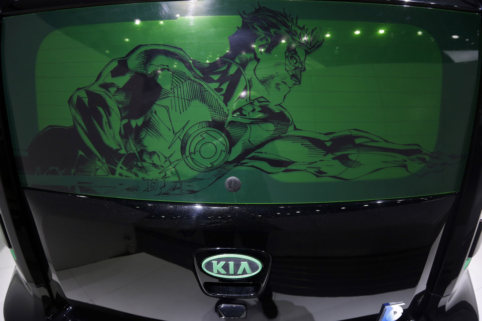 Photo - The rear hatch of the Green Lantern-wrapped Kia Soul is displayed at the North American International Auto Show in Detroit, Tuesday, Jan. 15, 2013. The comic inspired auto at the South Korean automaker's exhibit was created to promote an effort to fight hunger in Africa. Features include the Green Lantern's symbol on the Soul's wheels. The vehicle was created as part of a partnership involving DC Entertainment. The