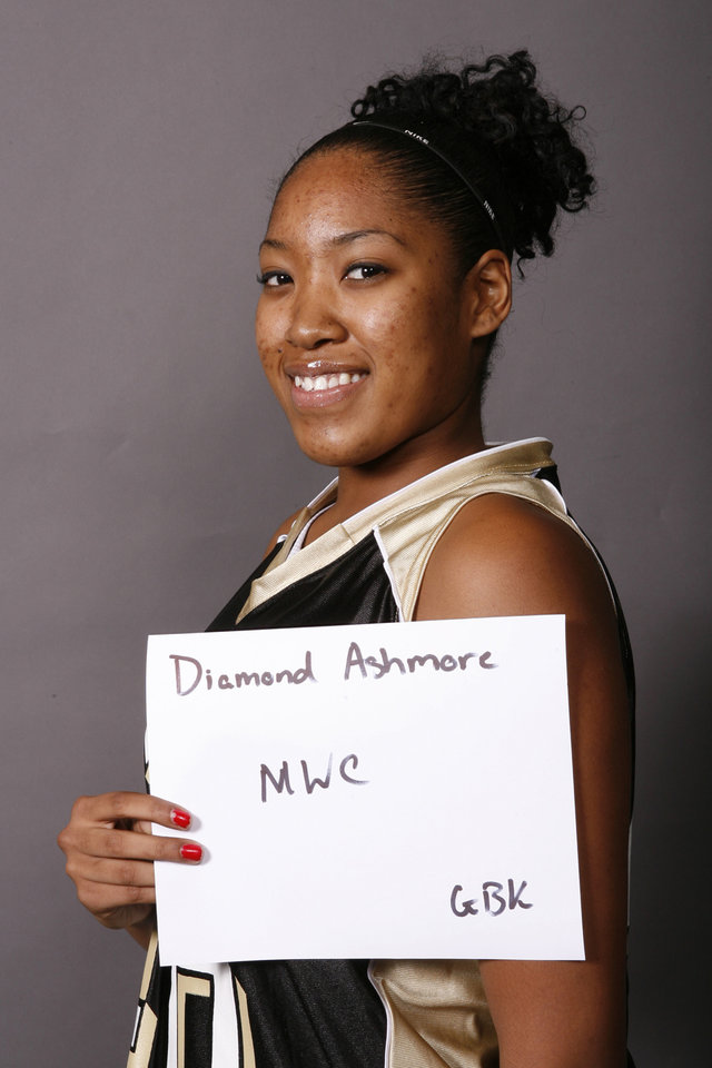 Photo - Diamond Ashmore, Midwest City, girls baketball, poses for a mug during The Oklahoman's Winter High School Sports All-City Photo Day, Wednesday, Nov. 14, 2007 . By Nate Billings, The Oklahoman ORG XMIT: KOD