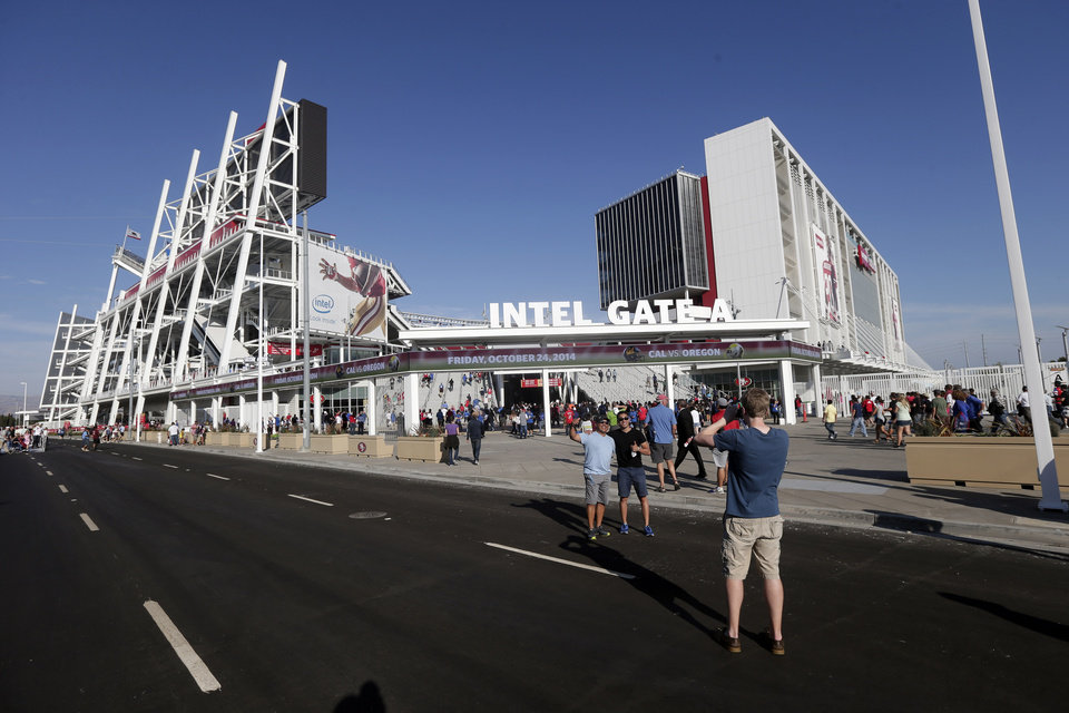 Photo - Fans take pictures outside the new Levi's Stadium before an MLS soccer match between the San Jose Earthquakes and the Seattle Sounders on Saturday, Aug. 2, 2014, in Santa Clara, Calif. (AP Photo/Marcio Jose Sanchez)