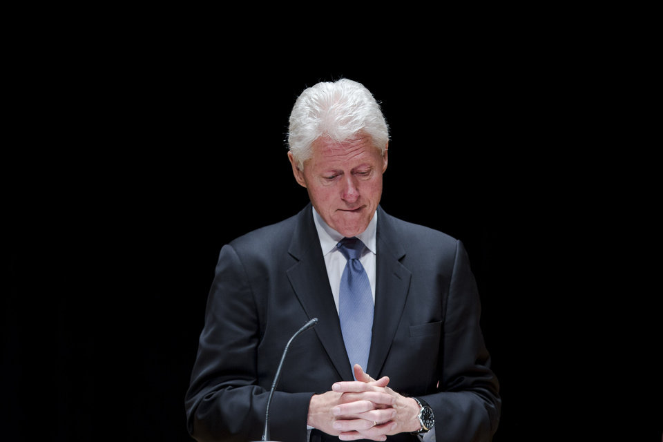 Photo - Former President Bill Clinton speaks during a public memorial service for Philadelphia Inquirer co-owner Lewis Katz Wednesday, June 4, 2014, at Temple University in Philadelphia. Katz and six others died when his private jet crashed during takeoff on Saturday, May 31, 2014 in Massachusetts. He was 72.  (AP Photo/Matt Rourke)