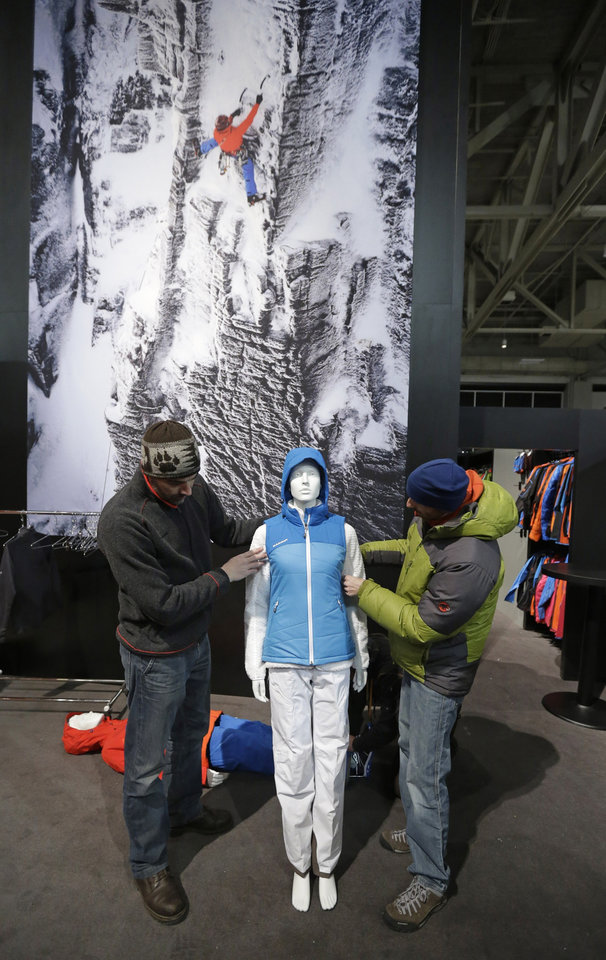 Workers form Mammut dress a mannequin while setting up their display at the Outdoor Retailer show Tuesday, Jan. 22, 2013, in Salt Lake City. The Outdoor Retailer show, which kicks off this Wednesday at the Salt Palace Convention Center, draws more than 25,000 people and pours more than $40 million into Utah�s economy every year. One of the world's largest outdoor gear trade shows will remain in Salt Lake City at least through 2016. The shows were previously contracted to stay through 2014. (AP Photo/Rick Bowmer)