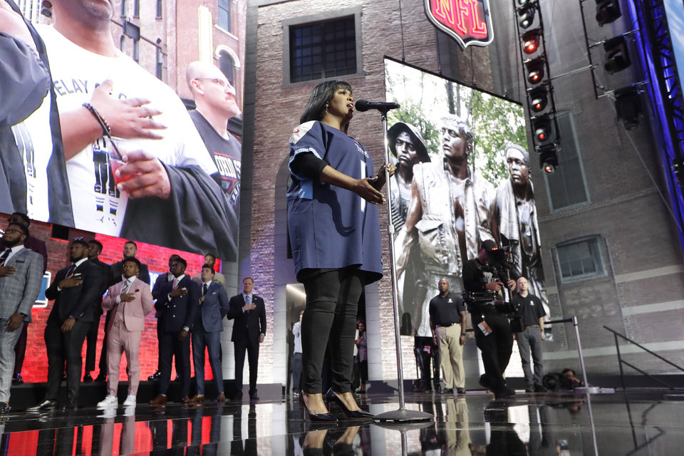 Photo - CeCe Winans sings the national anthem ahead of the first round of the NFL football draft, Thursday, April 25, 2019, in Nashville, Tenn. (AP Photo/Mark Humphrey)