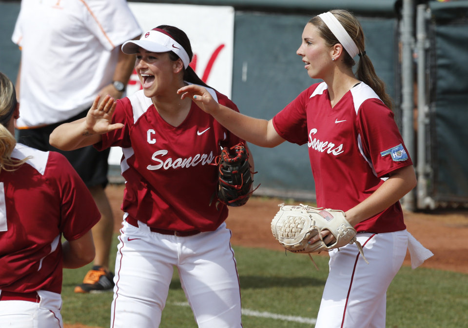 Photo - Oklahoma's Lauren Chamberlain and Kelsey Stevens celebrate a double play to end the inning as the University of Oklahoma Sooner (OU) softball team plays Tennessee in game two of the NCAA super regional at Marita Hynes Field on May 24, 2014 in Norman, Okla. Photo by Steve Sisney, The Oklahoman