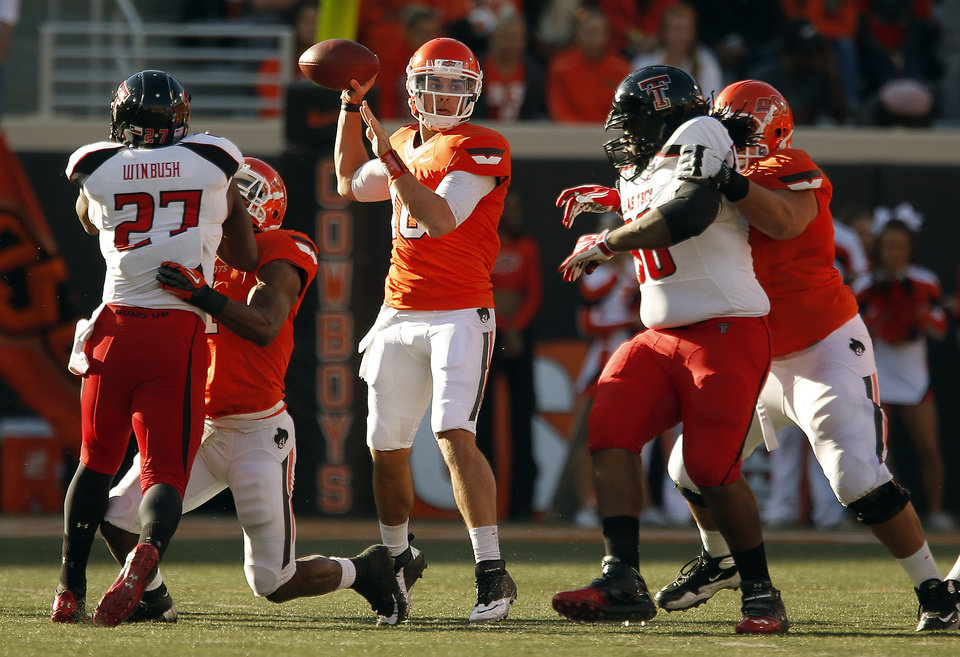 Photo - Oklahoma State's Clint Chelf (10) throws a pass during a college football game between Oklahoma State University and the Texas Tech University (TTU) at Boone Pickens Stadium in Stillwater, Okla., Saturday, Nov. 17, 2012. Photo by Sarah Phipps, The Oklahoman