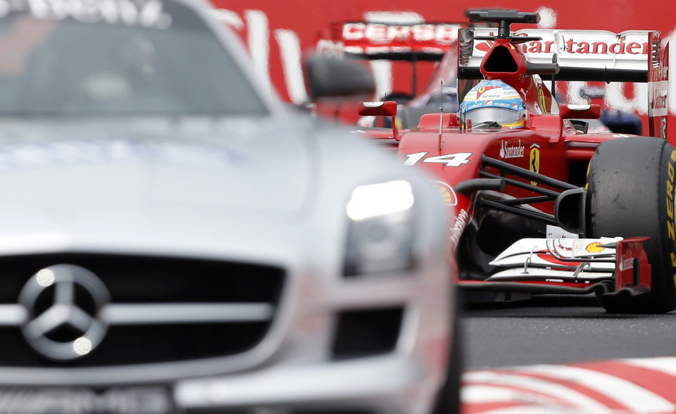 Photo - Ferrari driver Fernando Alonso of Spain follows the safety car during the Hungarian Formula One Grand Prix in Budapest, Hungary, Sunday, July 27, 2014. (AP Photo/Darko Vojinovic)