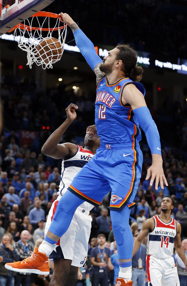 Photo - Oklahoma City's Steven Adams (12) dunks the ball past Washington's Isaac Bonga (17) in the first quarter during an NBA basketball game between the Oklahoma City Thunder and the Washington Wizards at Chesapeake Energy Arena in Oklahoma City, Friday, Oct. 25, 2019. [Nate Billings/The Oklahoman]