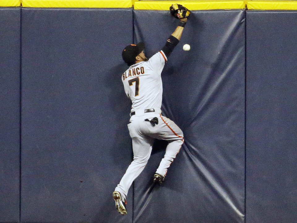 Photo - San Francisco Giants center fielder Gregor Blanco can't catch a ball hit by Milwaukee Brewers' Jonathan Lucroy during the sixth inning of a baseball game Tuesday, Aug. 5, 2014, in Milwaukee. (AP Photo/Morry Gash)