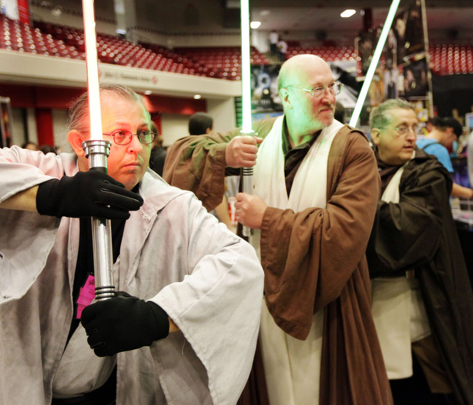 Photo - Robert Collins as Dark Lord Waya Night Walker, Scott Lang as Lan/Ed Tul and Anthony Pagano as Jedi Anton pose as characters from Star Wars during Trek Expo  June 27, 2009. MIKE SIMONS/Tulsa World ORG XMIT: 0906272215513006