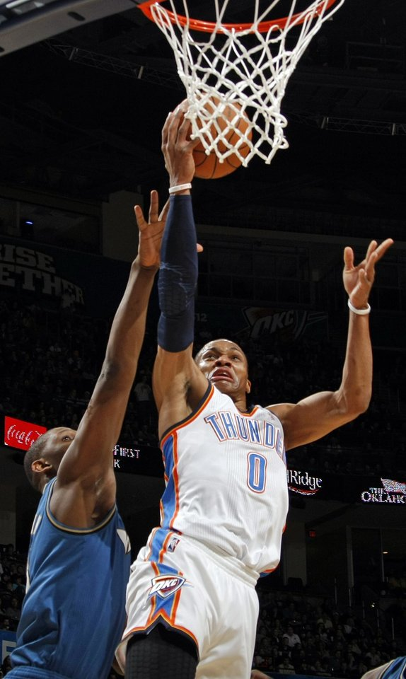 Photo - Oklahoma City's Russell Westbrook (0) takes a shot during the NBA basketball game between the Washington Wizards and the Oklahoma City Thunder at the Oklahoma City Arena in Oklahoma City, Friday, January 28, 2011. Photo by Nate Billings, The Oklahoman