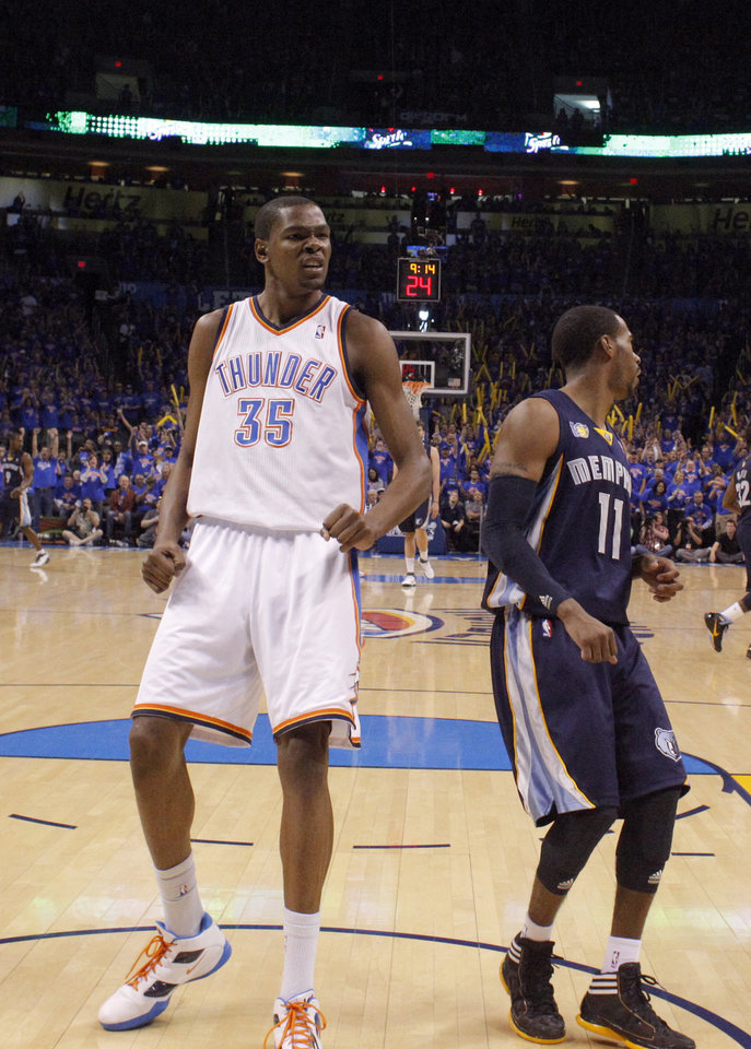 Oklahoma City's Kevin Durant (35) celebrates next to Mike Conley (11) of Memphis during game 7 of the NBA basketball Western Conference semifinals between the Memphis Grizzlies and the Oklahoma City Thunder at the OKC Arena in Oklahoma City, Sunday, May 15, 2011. Photo by Sarah Phipps, The Oklahoman