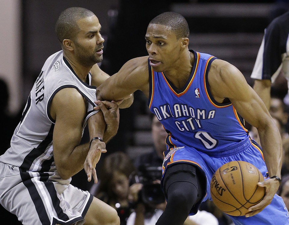 Photo - Oklahoma Thunder's Russell Westbrook (0) is pressured by San Antonio Spurs' Tony Parker, left, of France, during the second quarter of an NBA basketball game, Thursday, Nov. 1, 2012, in San Antonio. (AP Photo/Eric Gay) ORG XMIT: TXEG110