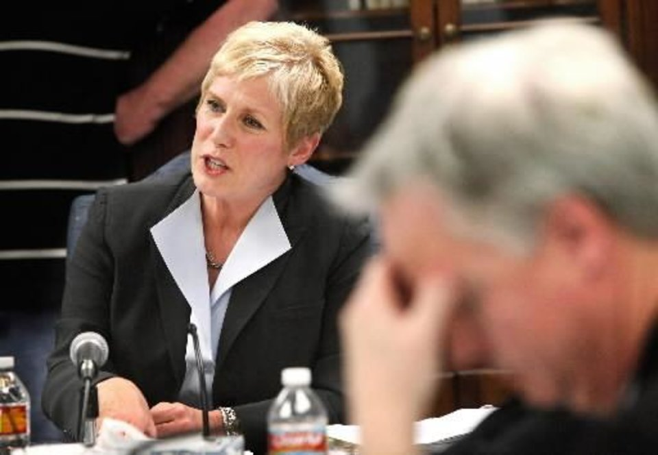 Photo - State schools Superintendent Janet Barresi, left, conducts the first meeting of the state Board of Education since she took office earlier this month on Jan. 27, 2011 in Oklahoma City, Oka. AP Photo/The Oklahoman, Jim Beckel)