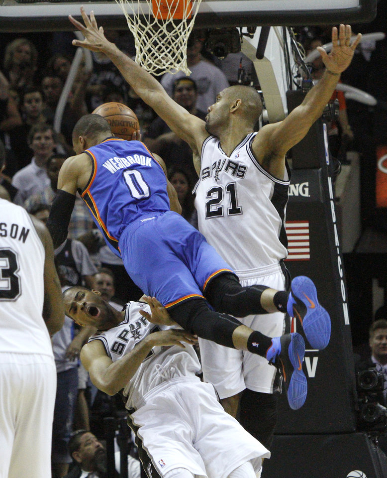 Oklahoma City\'s Russell Westbrook (0) runs into San Antonio\'s Gary Neal (14) and Tim Duncan (21) during Game 1 of the Western Conference Finals between the Oklahoma City Thunder and the San Antonio Spurs in the NBA playoffs at the AT&T Center in San Antonio, Texas, Sunday, May 27, 2012. Oklahoma City lost 101-98. Photo by Bryan Terry, The Oklahoman