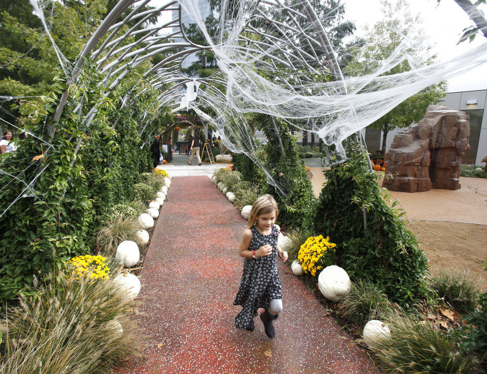 Photo - Children enjoy the decorated paths at Pumpkinville at the Botanical Gardens in Oklahoma City, OK, Saturday, October 13, 2012,  By Paul Hellstern, The Oklahoman