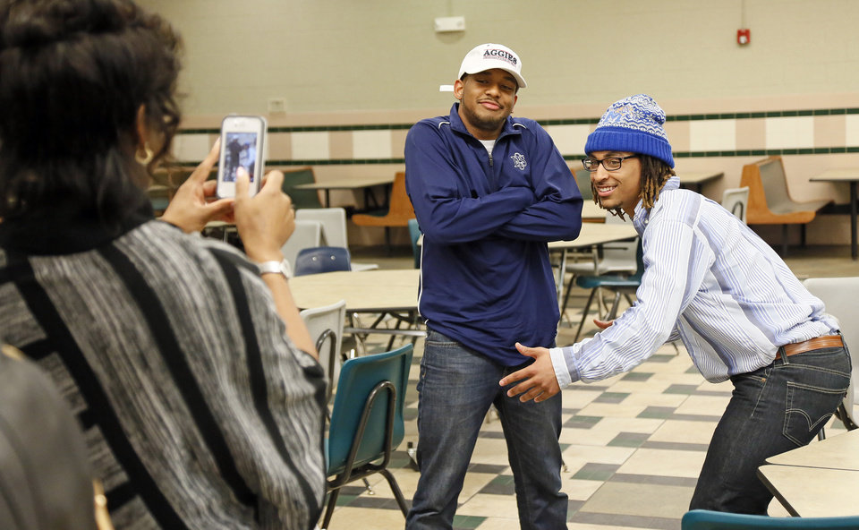 Photo - Jalaun Parker, left, and Phillip Sumpter pose for a photo after the signing day ceremony at Edmond Santa Fe High School in Edmond, Okla., Wednesday, Feb. 6, 2013. Parker will play football at Panhandle State, while Sumpter will play for Memphis. Photo by Nate Billings, The Oklahoman