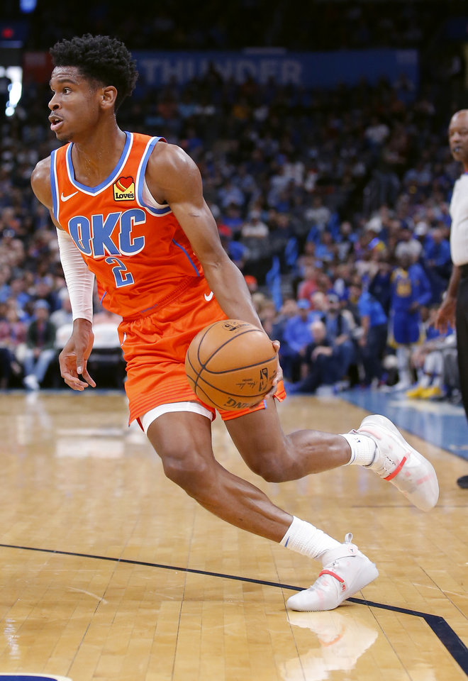 Photo - Oklahoma City's Shai Gilgeous-Alexander (2) drives to the basket during the NBA game between the Oklahoma City Thunder and Golden State Warriors at Chesapeake Energy Arena,  Sunday, Oct. 27, 2019. Thunder won 120-92.[Sarah Phipps/The Oklahoman]