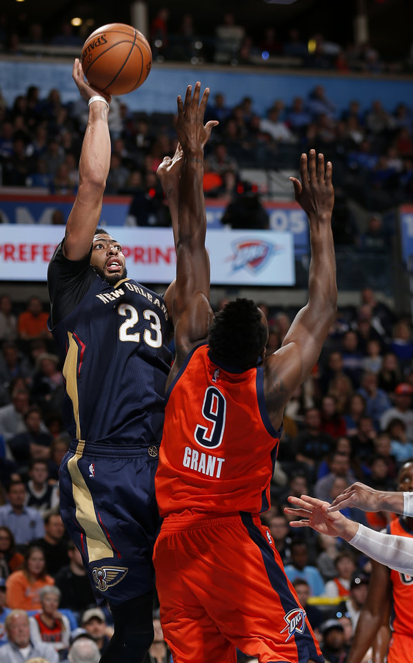 Photo - New Orleans' Anthony Davis (23) shoots over Oklahoma City's Jerami Grant (9) during the NBA game between the Oklahoma City Thunder and the New Orleans Pelicans at the Chesapeake Energy Arena,  Sunday, Dec. 4, 2016. Photo by Sarah Phipps, The Oklahoman