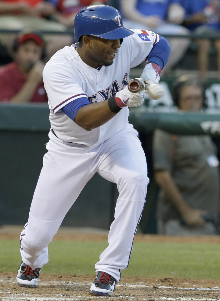 Photo - Texas Rangers Elvis Andrus bunts during the third inning of a baseball game against the Miami Marlins in Arlington, Texas, Tuesday, June 10, 2014. (AP Photo/LM Otero)