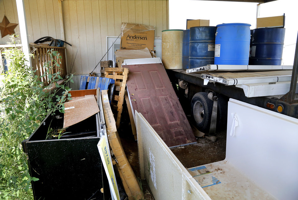 Photo -  A vacant mobile home located next to the trailer where Clayton Cook lives in Steelman Estates. Cook said Tonia Allen stashed construction materials in the mobile home next door, and he hasn't seen her for weeks.    Jim Beckel -  THE OKLAHOMAN