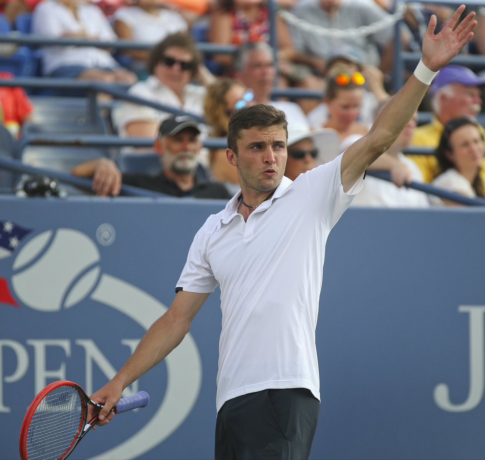 Photo - Gilles Simon, of France, reacts after a shot against Marin Cilic, of Croatia, during the fourth round of the 2014 U.S. Open tennis tournament, Tuesday, Sept. 2, 2014, in New York. (AP Photo/John Minchillo)