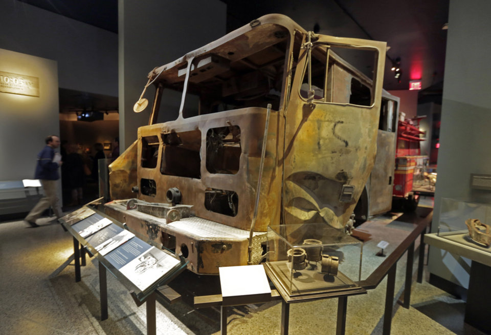 Photo - The remains of New York City Fire Dept. truck from Engine Company 21 are displayed at the National Sept. 11 Memorial Museum, Wednesday, May 14, 2014, in New York. The museum is a monument to how the Sept. 11 terror attacks shaped history, from its heart-wrenching artifacts to the underground space that houses them amid the remnants of the fallen twin towers' foundations. It also reflects the complexity of crafting a public understanding of the terrorist attacks and reconceiving ground zero.  (AP Photo)
