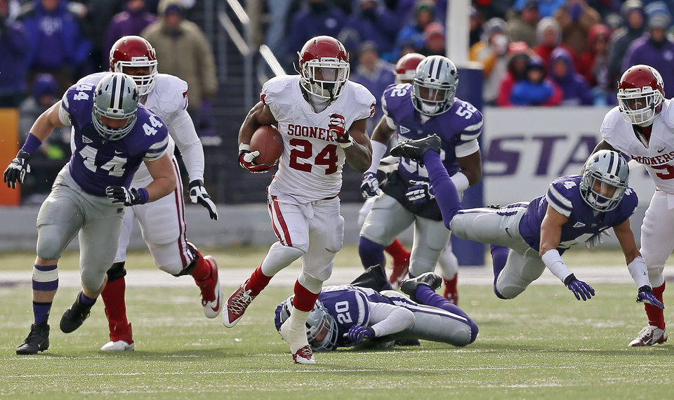 Oklahoma's Brennan Clay (24) runs for a 64-yard touchdown during an NCAA college football game between the Oklahoma Sooners and the Kansas State University Wildcats at Bill Snyder Family Stadium in Manhattan, Kan., Saturday, Nov. 23, 2013. Oklahoma won 41-31. Photo by Bryan Terry, The Oklahoman