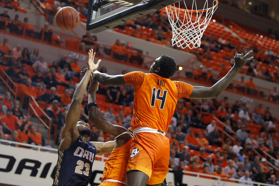 Photo - Oklahoma State's Yor Anei (14) blocks the shot of Oral Roberts' Emmanuel Nzekwesi (23) during an NCAA basketball game between the Oklahoma State University Cowboys (OSU) and the Oral Roberts Golden Eagles (ORU) at Gallagher-Iba Arena in Stillwater, Okla., Wednesday, Nov. 6, 2019. Oklahoma State won 80-75. [Bryan Terry/The Oklahoman]