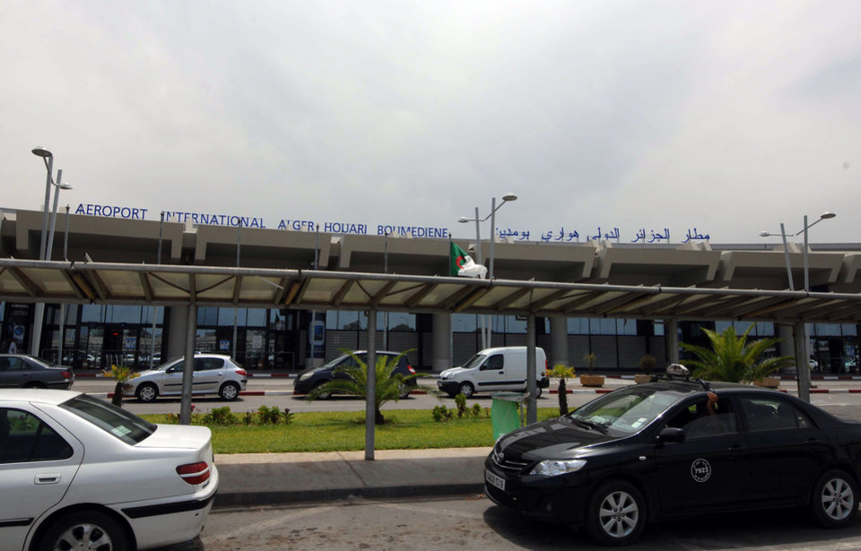 Photo - Vehicles are parked outside the Houari Boumedienne international airport near Algiers, Algeria, Thursday, July 24, 2014. An Air Algerie flight carrying 116 people from Burkina Faso to Algeria's capital disappeared from radar early Thursday over northern Mali and