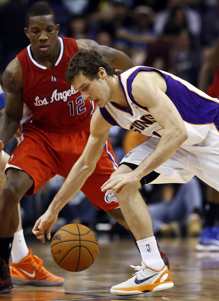 Phoenix Suns' Goran Dragic, right, of Slovenia, tries to control the ball in front of Los Angeles Clippers' Eric Bledsoe (12) during the first half of an NBA basketball game, Thursday, Jan. 24, 2013, in Phoenix. (AP Photo/Ross D. Franklin)