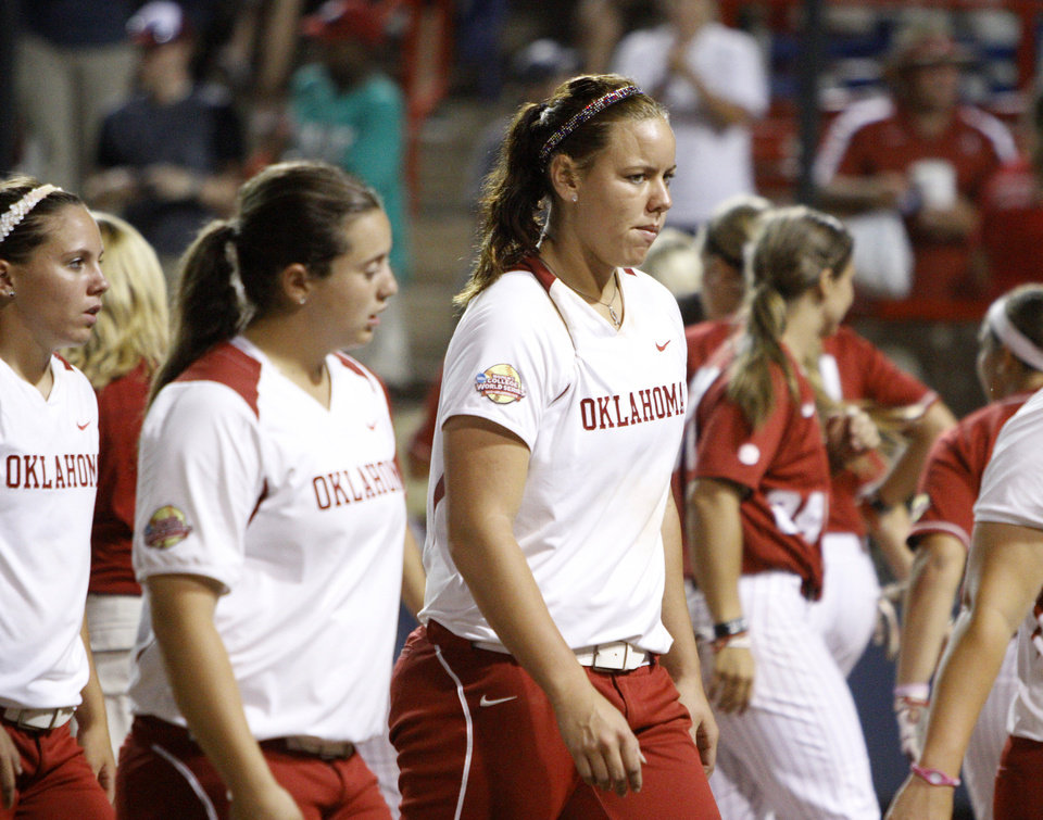 Photo - Oklahoma's Keilani Ricketts (10) walks off the field after OU's 8-6 loss during the championship game of the Women's College World Series against Alabama as ASA Stadium in Oklahoma City, Tuesday, June 5, 2012. Photo by Bryan Terry, The Oklahoman
