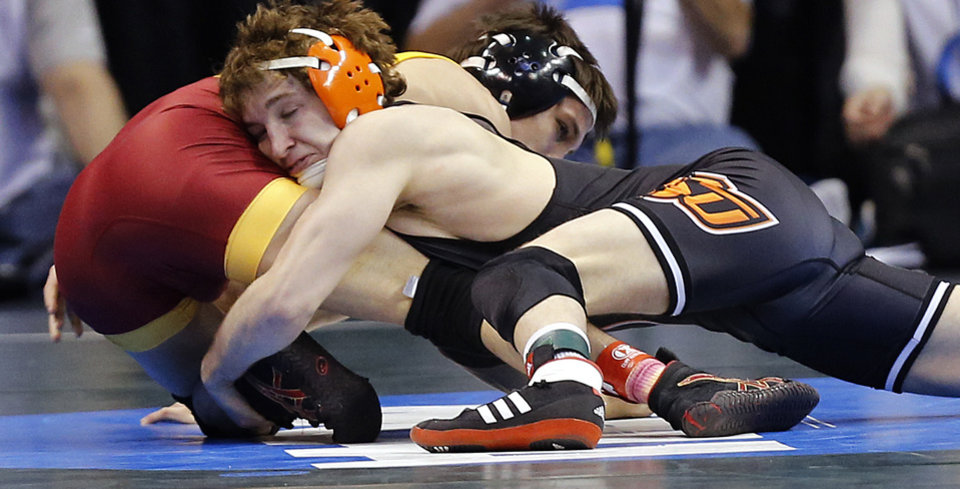 Photo - Oklahoma State's Anthony Collica takes on Iowa State's Gabe Moreno in the 141 pound match during the 2014 NCAA Div. 1 Wrestling Championships at Chesapeake Energy Arena in Oklahoma City, Okla. on Friday, March 21, 2014. Photo by Chris Landsberger, The Oklahoman