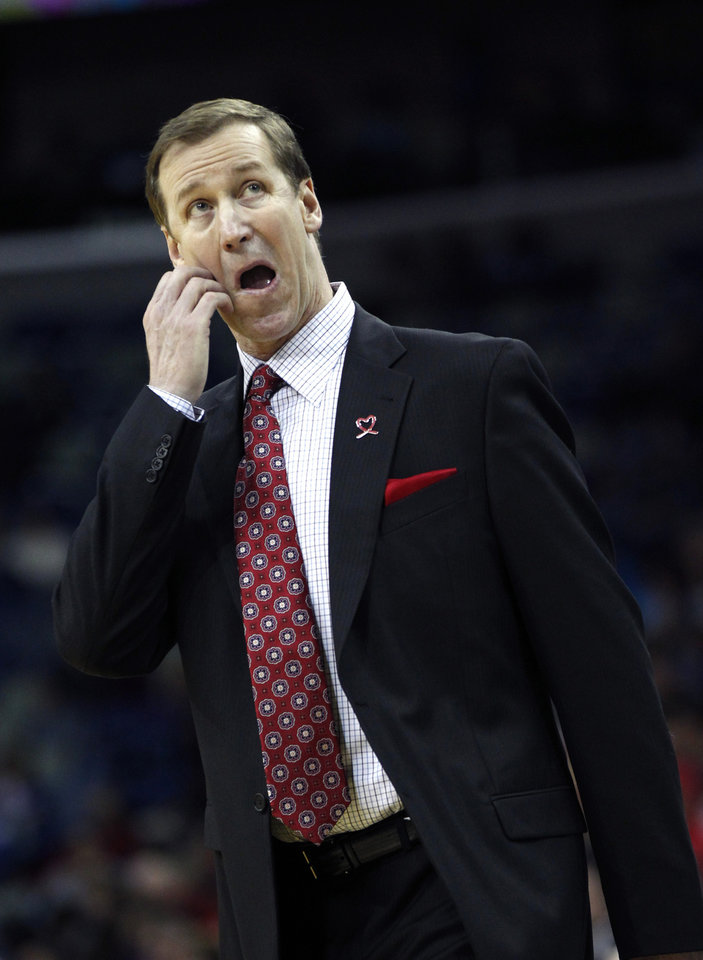 Photo - Portland Trail Blazers coach Terry Stotts reacts during the first half of an NBA basketball game against the New Orleans Hornets in New Orleans, Wednesday, Feb. 13, 2013. (AP Photo/Gerald Herbert)