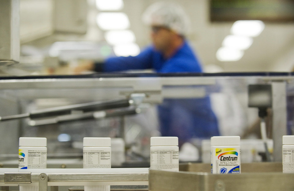 FILE- In this Thursday, July 12, 2012, file photo, Centrum multivitamins are shown on the packaging line at the Pfizer plant in Montreal Drugmaker Pfizer Inc. said Monday, Dec. , 2012, it is starting another round of layoffs, targeting U.S. sales representatives who promote Pfizer primary care medicines to doctors. The New York-based Viagra maker isn't giving details on how many salespeople it employs, how many will leave or when that will happen. Individual salespeople haven't been notified whether they'll be furloughed.(AP Photo/The Canadian Press, Graham Hughes, File)