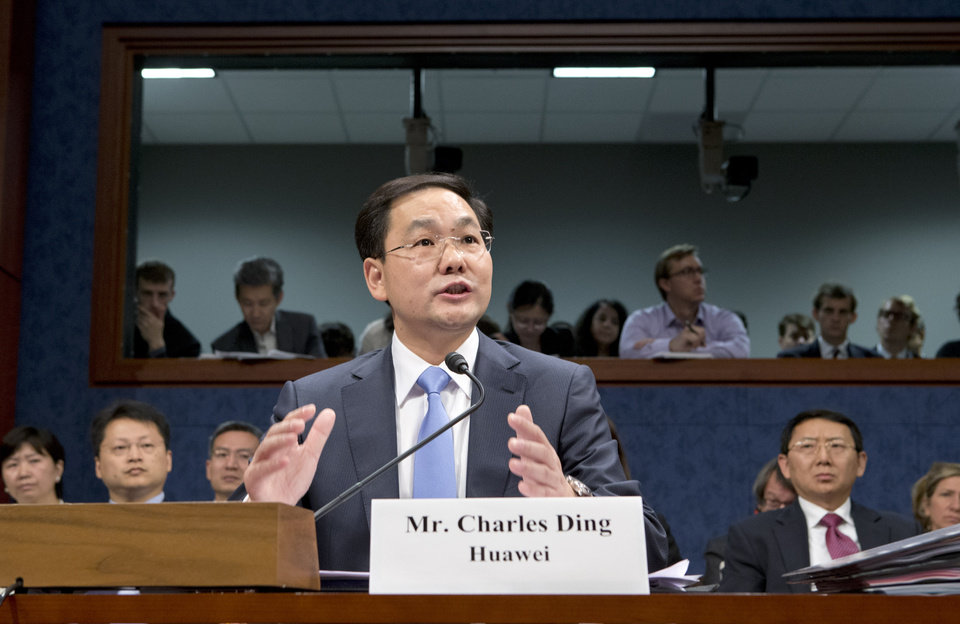 FILE - In this Sept. 13, 2012, Charles Ding, Huawei Technologies Ltd\'s senior vice president for the U.S., testifies on Capitol Hill in Washington, before the House Intelligence Committee as lawmakers probe whether Chinese tech giants\' expansion in the U.S. market pose a threat to national security. In a report to be released Monday, Oct. 8, 2012, the House Intelligence Committee is warning that China\'s two leading technology firms pose a major security threat to the United States. The panel says regulators should block mergers and acquisitions in the U.S. by Huawei Technologies Ltd. and ZTE Corp. It also advises that U.S. government systems not include equipment from the two firms, and that private U.S. companies avoid business with them. (AP Photo/J. Scott Applewhite, File)