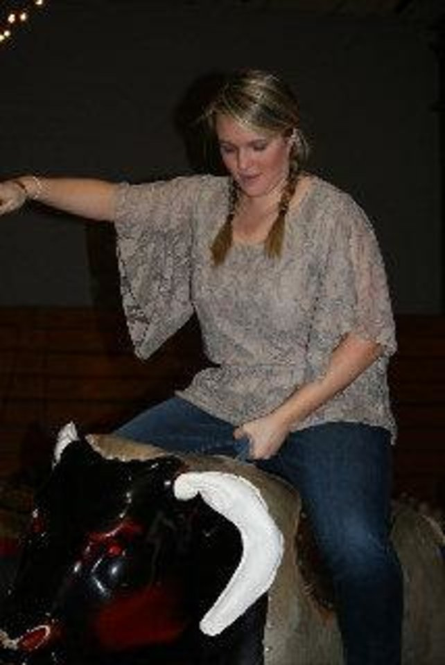 Jen Matias riding a mechanical bull. PHOTO PROVIDED. <strong></strong>
