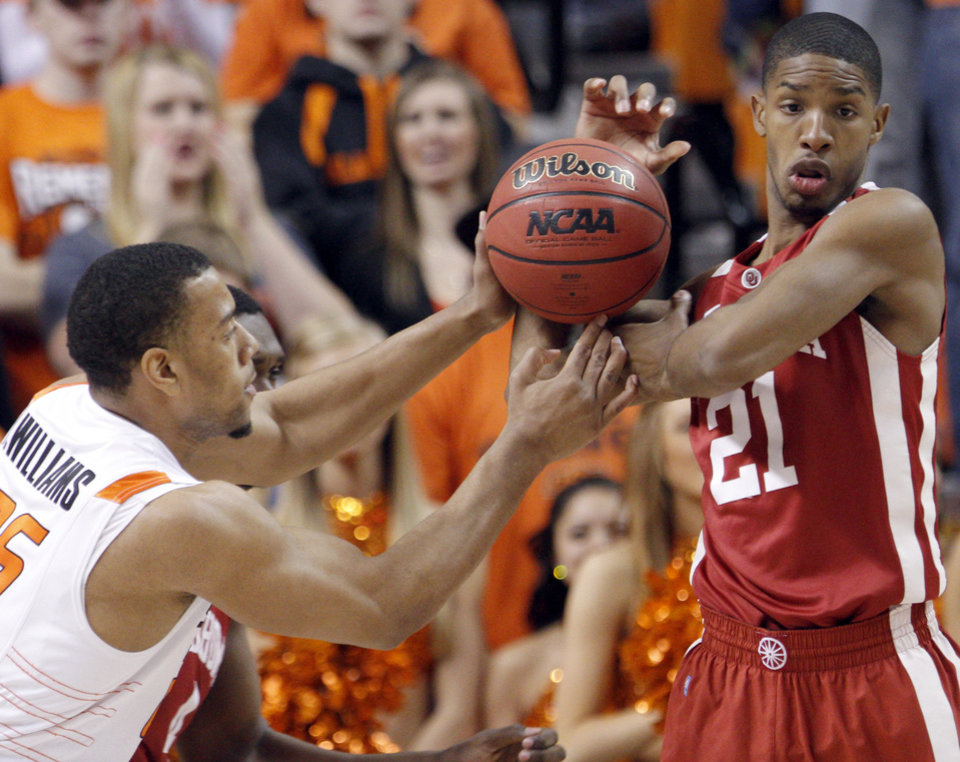 Oklahoma's Cameron Clark (21) and Oklahoma State's Darrell Williams (25) fight for a loose ball during the Bedlam men's college basketball game between the University of Oklahoma Sooners and Oklahoma State University Cowboys at Gallagher-Iba Arena in Stillwater, Okla., Saturday, February, 5, 2011. Photo by Sarah Phipps, The Oklahoman