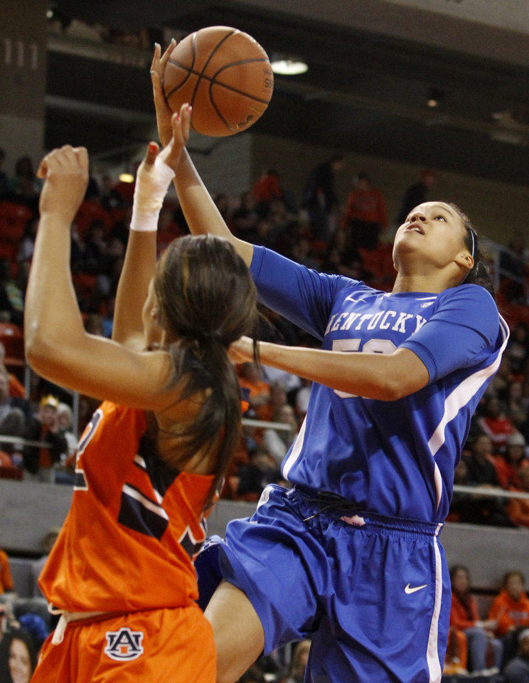 Photo - Kentucky;s Azia Bishop, right, goes up to shoot over Auburn's Tyrese Tanner during the first half of an NCAA college basketball game on Sunday, Jan. 19, 2014, in Auburn, Ala. (AP Photo/Butch Dill)
