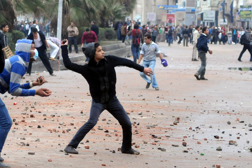 Opponents of Egyptian President Mohammed Morsi clash with Islamist supporters of the president, unseen in Alexandria, Egypt, Friday, Dec. 21, 2012. Thousands of Islamists clashed with their opponents Friday in Egypt's second largest city, Alexandria, on the eve of the second leg of voting on the country's contentious constitution that has deeply polarized the nation.(AP Photo)