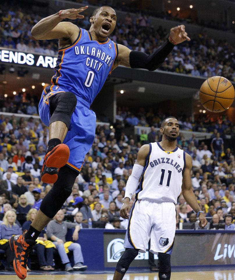 Oklahoma City's Russell Westbrook (0) celebrates as he comes down from a dunk in front of Memphis' Mike Conley (11) during Game 6  in the first round of the NBA playoffs between the Oklahoma City Thunder and the Memphis Grizzlies at FedExForum in Memphis, Tenn., Thursday, May 1, 2014. Photo by Bryan Terry, The Oklahoman