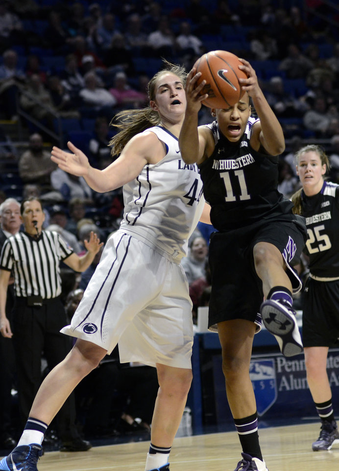 Photo - Northweastern's Lauren Douglas (11) pulls a rebound away from Penn State's Tori Waldner (44) during the first half of an NCAA basketball game in State College, Pa., Thursday, Feb. 20, 2014. (AP Photo/Ralph Wilson)