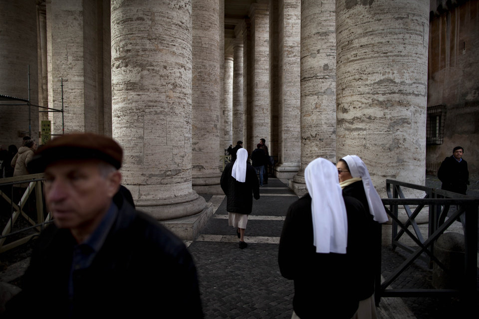 "Nuns walk in St Peter's Square, a day before Pope Benedict XVI's last general audience, at the Vatican, Tuesday, Feb. 26, 2013. Pope Benedict XVI will be known as ""emeritus pope"" in his retirement and will continue to wear a white cassock, the Vatican announced Tuesday, again fueling concerns about potential conflicts arising from having both a reigning and a retired pope.The pope's title and what he would wear have been a major source of speculation ever since Benedict stunned the world and announced he would resign on Thursday, the first pontiff to do so in 600 years. (AP Photo/Oded Balilty)"