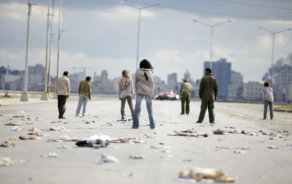 Photo - FILE - In this Dec. 5, 2010 file photo, extras dressed as zombies take positions during the filming of the movie 'Juan de los Muertos,' or, 'Juan of the Dead' in Havana, Cuba. Screenings of the film by writer-director Alejandro Brugues started the week of Dec. 8, 2011 in Havana.  (AP Photo/Javier Galeano, File) ORG XMIT: XLAT122
