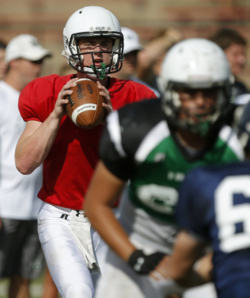 Photo - Jacob Lewis of Bishop McGuinness drops back to pass during a high school football scrimmage at Mustang, Thursday, August 29, 2013. Photo by Bryan Terry, The Oklahoman