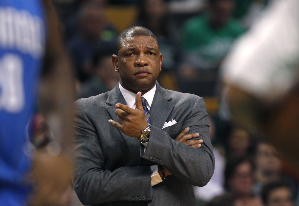 Photo - FILE - In this file photo made Feb. 1, 2013, Boston Celtics head coach Doc Rivers gestures towards an official during an NBA basketball game against the Orlando Magic in Boston. A Celtics official told The Associated Press, Sunday, June 23, 2013, that a deal to allow Rivers to coach the Los Angeles Clippers has been agreed to. The official spoke on the condition of anonymity because the deal was contingent on NBA approval and negotiations between Rivers and the Clippers over a new contract. (AP Photo/Charles Krupa, file)