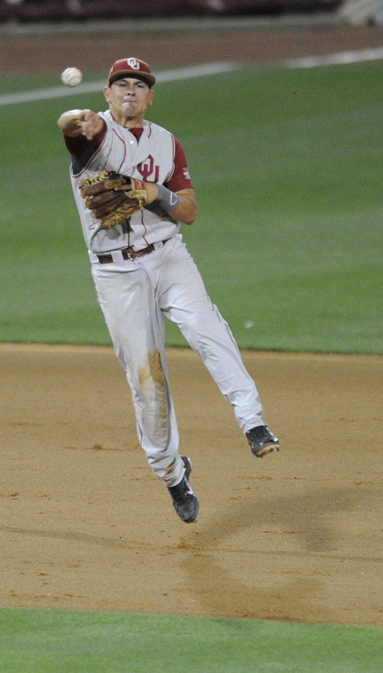 Photo - Oklahoma's Caleb Bushyhead (5) fields to first base against South Carolina in the eight inning of an NCAA college super regional baseball tournament game in Columbia, S.C., Saturday, June 9, 2012. (AP Photo/Mary Ann Chastain) ORG XMIT: SCMC113