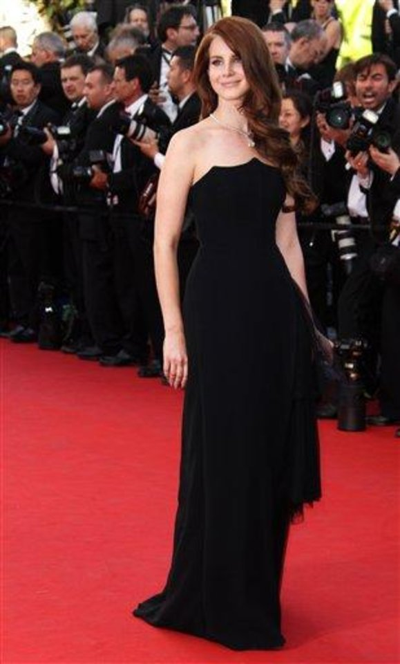 Photo - Singer Lana Del Ray arrives for the opening ceremony and screening of Moonrise Kingdom at the 65th international film festival, in Cannes, southern France, Wednesday, May 16, 2012. Del Ray is wearing a dress by the house of Alexander McQueen. (AP Photo/Joel Ryan)