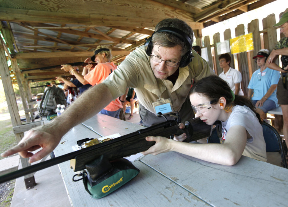 Michelle Hellstern receives rifle instruction from Dr. Stephen Veronneau during the annual Women\'s Only Fun Shoot at the Oklahoma City Gun Club north of Arcadia, OK, Saturday, September 7, 2013, Photo by Paul Hellstern, The Oklahoman